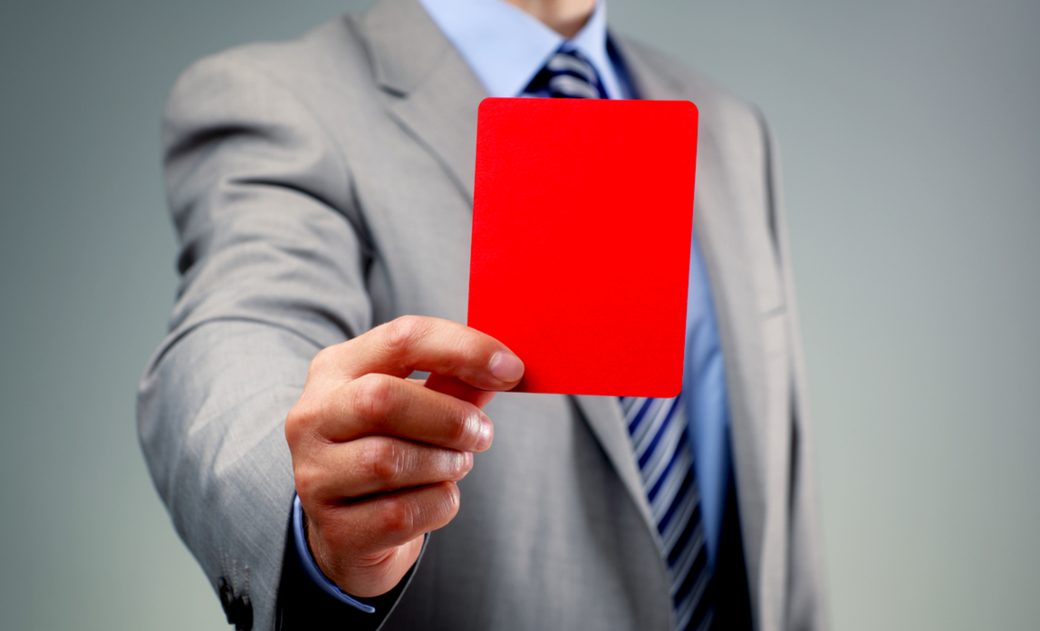 Man showing a red card - A guide to tax penalties.
