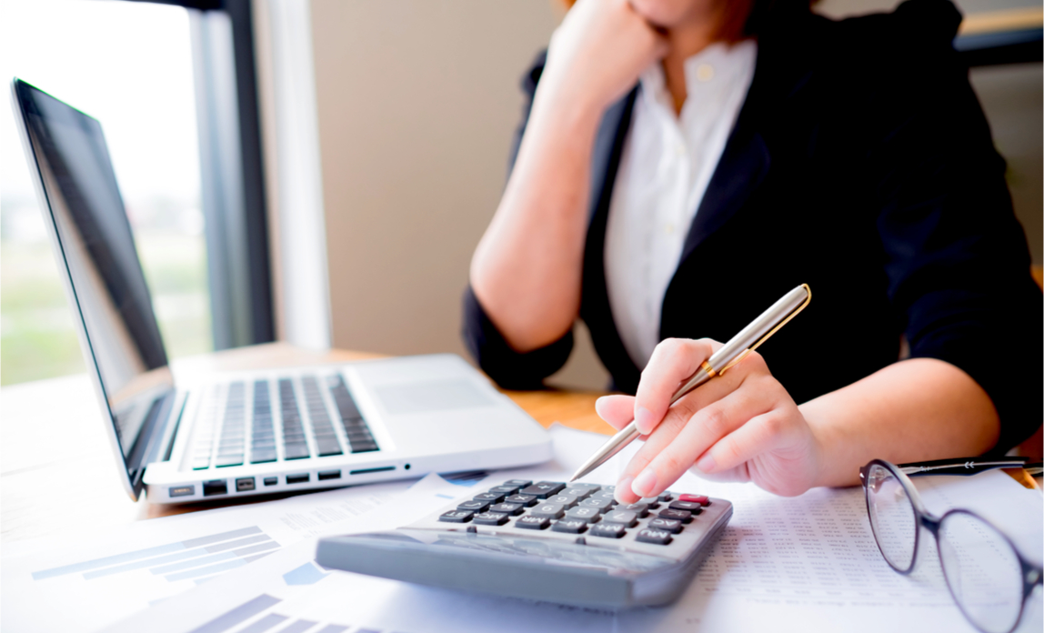 A business accountant works out her client's tax liabilities in 2019.