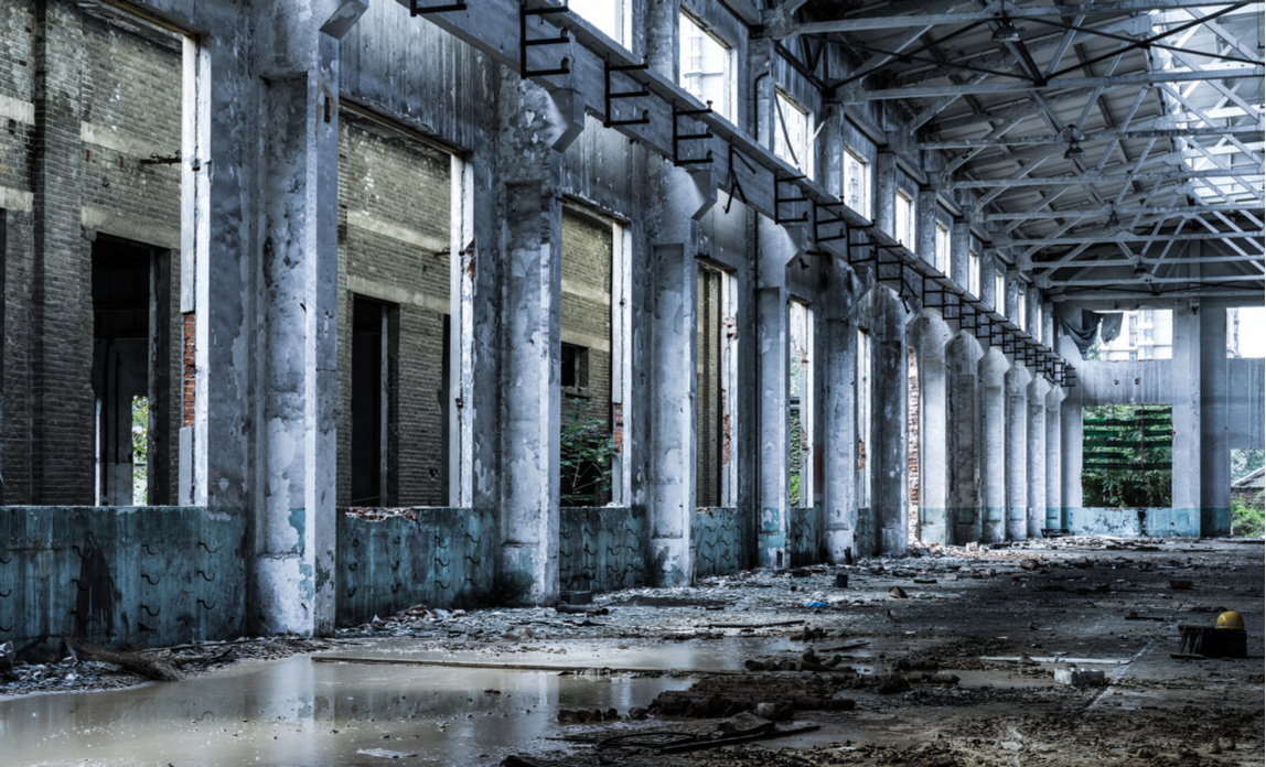 An interior shot of an abandoned factory building, ready for redevelopment.