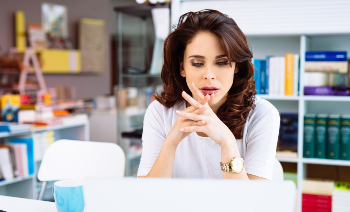 Woman entrepreneur worryingly looking at her laptop screen