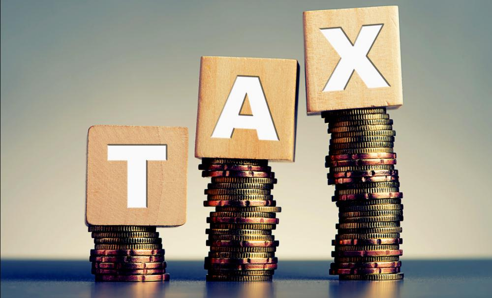 How does tax affect a specific business?