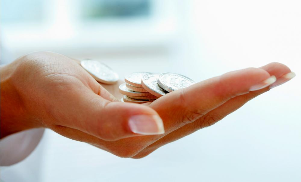 Claim a national insurance rebate - hand with coins