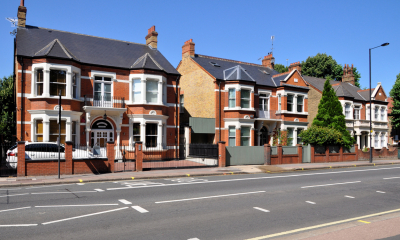 Multiple detached properties by the road on a sunny day