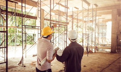 Two building developers discuss their business plans for the construction site they are purchasing with a bridging loan