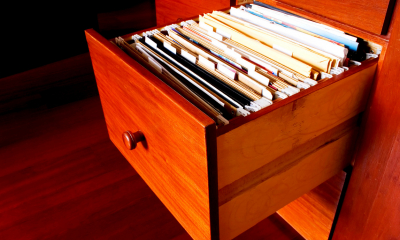 Wooden drawer filled with corporation tax records