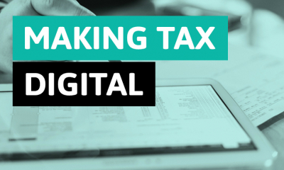 A blurred screen with the writing Making Tax Digital in front of it