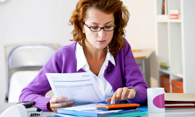 A self employed woman submits her expenses ready for her self assessment tax return