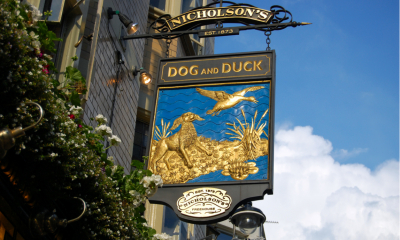 Pub sign with a blue sky backdrop