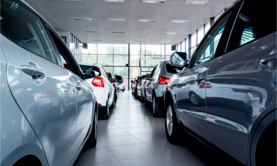 A car showroom is full of company cars waiting to be collected