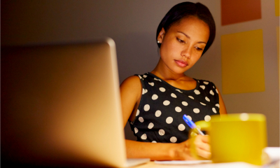 A female employee works late into the night from home