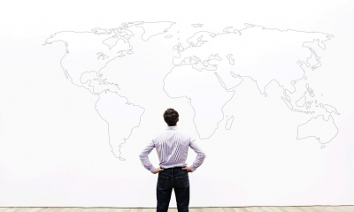 A sole trader considers a map of the world