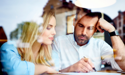 Man and woman working through financial figures