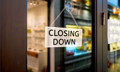 Closing down sign on the door of a high street payday lender