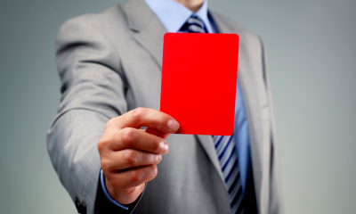 Man holding a red card