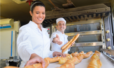 An apprentice working in a bakery