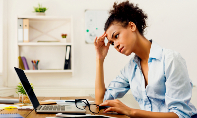 A female freelancer nurses a headache as she works
