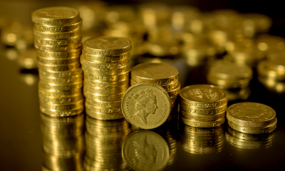 Pile of pound coins - Understand Stamp Duty and Capital Gains Tax.