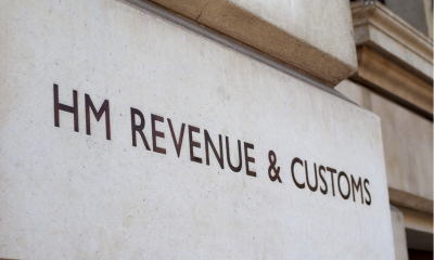 'HM REVENUE & CUSTOMS' written on the wall outside of a building