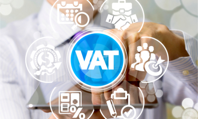 A man uses a tablet pc to complete a digital MTD-compliant VAT return representing the concept of Value Added Tax.